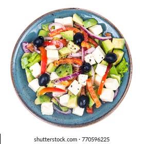 Greek salad with feta, avocado and black olives. Studio Photo