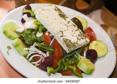 greek salad with feta cheese slice in taverna restaurant as photographed in santorini greek islands