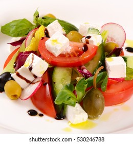 Greek salad with fresh herbs close up