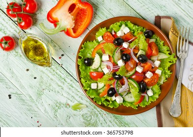 Greek salad with fresh vegetables, feta cheese and black olives. Healthy fresh vegetarian food. Top view