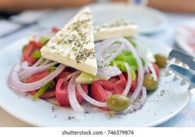 Greek salad with fresh vegetables, feta cheese and green olives