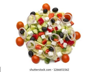 Greek salad on isolated background. fresh vegetable salad lies