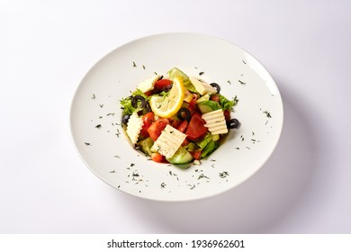 greek salad. on a white background