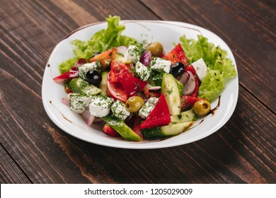 Greek salad on a white plate
