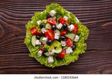 Greek salad on a wooden rustic background