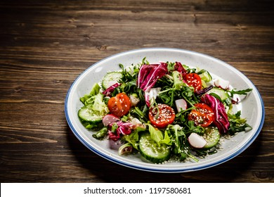 Greek salad on wooden table