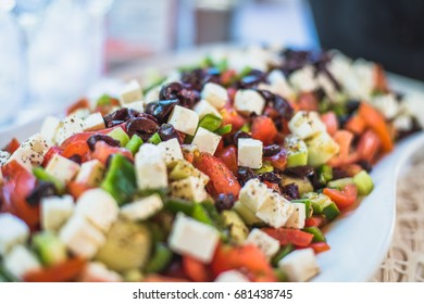Greek salad. Prepared for wedding feast or catering. Olives, tomato, cheese, paprika.
