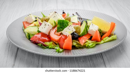 Greek salad with vegetables and spices in a plate