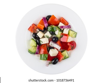 Greek salad and in white glass plate isolated on white background. Top view