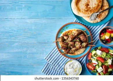 Greek souvlaki with pita bread, tzatziki sauce and salad.Copy space
