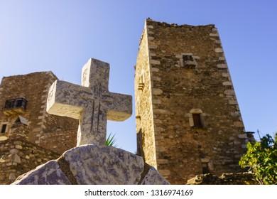 Greek stone cross and tower house, greek architecture, Vathia Mani Greece