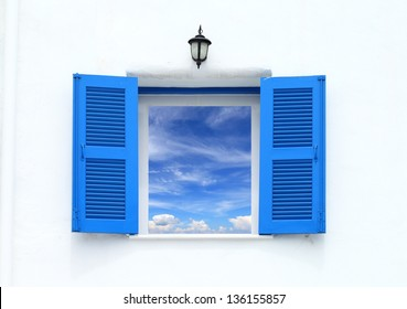 Greek Style windows and lamp with blue sky view