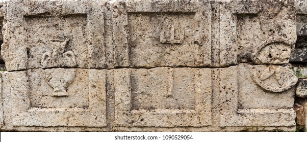 Greek symols on stone plate in ancient city Hierapolis
