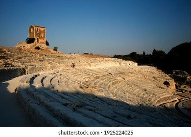 the greek Theatre at the Siracusa Parco archeologico in the old Town of Siracusa in the province of Sicily in Italy.   Italy, Sicily, October, 2014