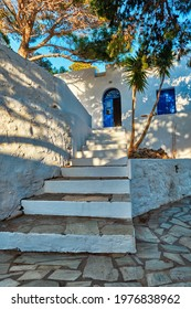 Greek village typical view with whitewashed houses and stairs and blue doors. Plaka town, Milos island, Greece