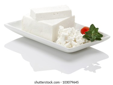 greek white cheese(feta) made of sheep milk in a white plate