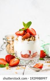 Greek yogurt with fresh strawberry and granola. Parfait.