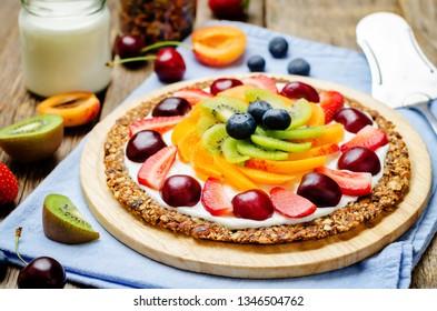 Greek yogurt granola fruit breakfast pizza. toning. selective focus