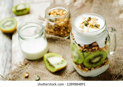 Greek yogurt granola kiwi breakfast in jar. toning. selective focus