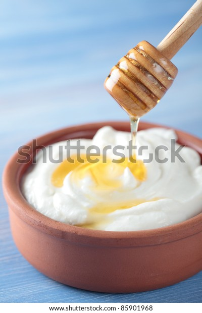 Greek yogurt with honey in a pot