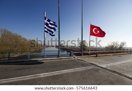 The Greek-Turkish border line right on the bridge over the river Evros, in Thrace region. The grey line on the road marks the exact point where the two countries meet or separate.