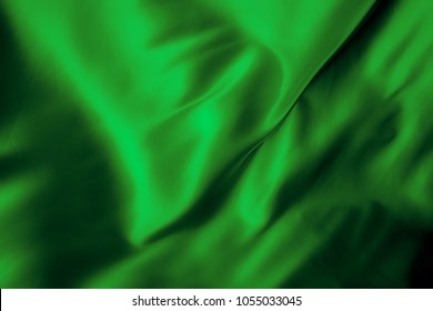 green abstract background luxury cloth or liquid wave or wavy folds of grunge silk texture satin velvet material or luxurious Christmas background or elegant wallpaper design, background