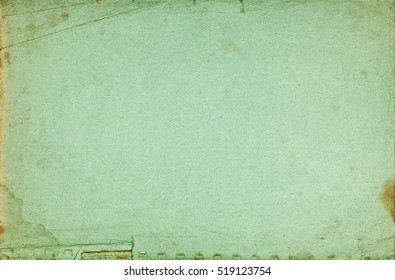Green abstract exercise book cover textured page with folds, stains, torn border and fading effect
