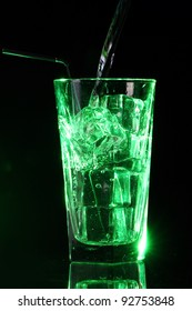 Green acid cocktail with ice