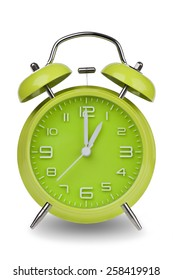 Green alarm clock with the hands at 1 am or pm isolated on a white background. One of a set of 12 images showing the top of the hour starting with 1 am / pm and going through all 12 hours