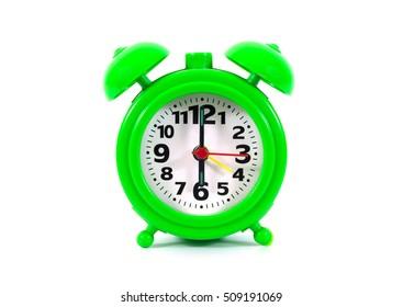 Green alarm clock.Plastic alarm clock isolated on white background