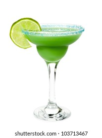 green alcoholic cocktail with blue sugar on the edge of the glass and a slice of lime