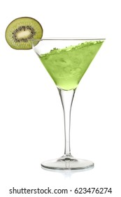 Green alcoholic cocktail with leaning liquid and a kiwi