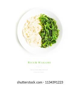 Green algae salad on white isolated background. Hiyashi wakame. Wakame salad with chopsticks for sushi. Rice with algae in a white plate.