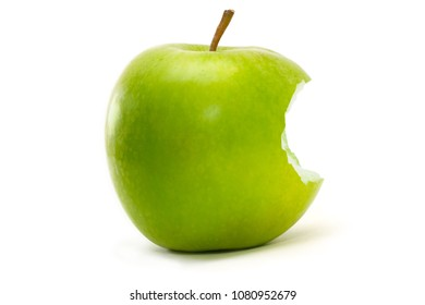 Green apple with bite isolated over a white background.