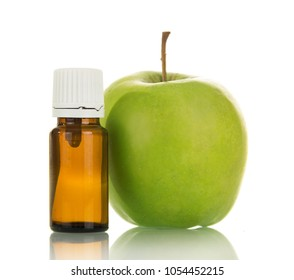 Green Apple and bottle of aromatic liquid for electronic Smoking, isolated on white