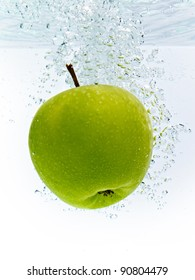 green apple dropped into water