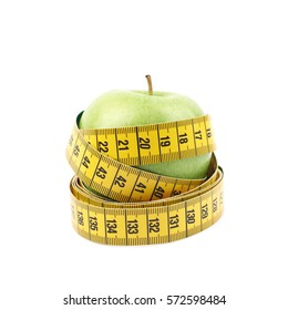 Green apple fruit tied with the dieting measuring tape, composition isolated over the white background