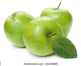 Green apple fruits and green leaves isolated on white background