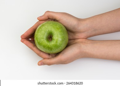 Green Apple in Hand on White Background