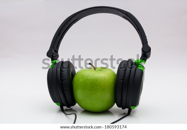 Green apple with headphone
