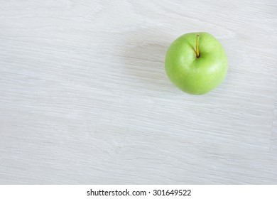 green apple isolated on a table,top view