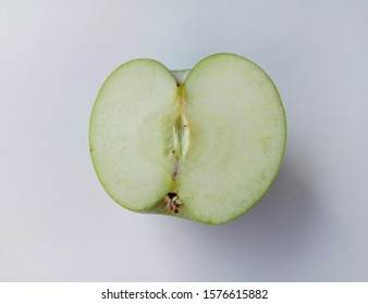 Green apple (Malus domestica) slice  isolated on white background closeup. Give a sweet or sour taste Fruit is beautiful, peel, some fruit. Crispy popular eating as fresh fruit And processed.