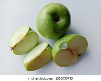Green apple (Malus domestica) slices isolated on white background closeup. Give a sweet or sour taste Fruit is beautiful, peel, some fruit. Crispy popular eating as fresh fruit.