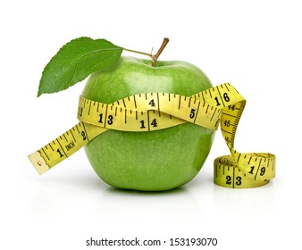 Green apple with measuring tape isolated on white background