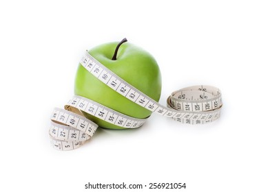 Green apple with measuring tape isolated on white background, Healthy lifestyle concept