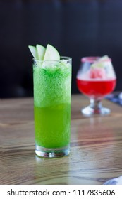 Green Apple Mocktail Non Alcoholic on wooden table