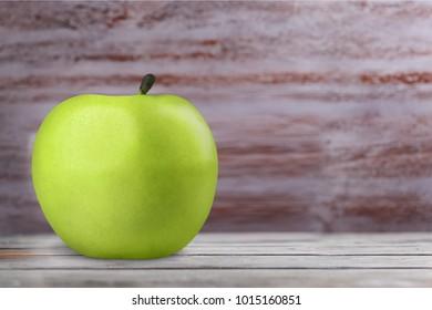 Green apple on desk