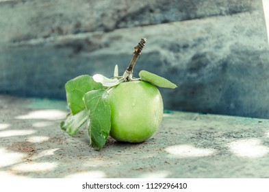 Green apple on table, macro fruits
