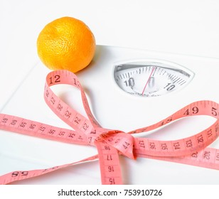 Green apple, Orange, pink measuring tape,Weight Scale, Notebook and pen on white table. Selective focus.Health care concept.