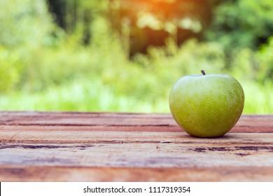 Green apple put on wooden.